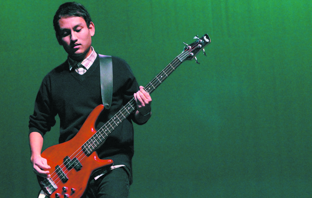 Students exhibit musical talents on stage among peers for generous award