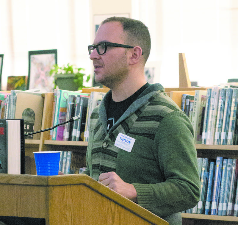 """Author Cory Doctorow speaks to students in the library about """"Homeland"""", his sequel to """"Little Brother""""."""