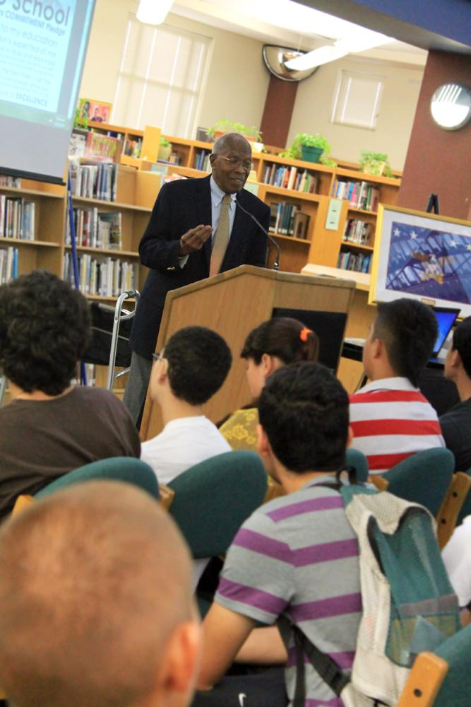 Dr. Charles Akins speaks to students at the annual