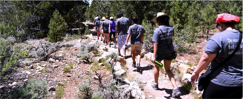Members of the Outdoor Education Program rove the rigorous Grand Canyon trail. Club members took water bottles and sun hats to protect themselves from the heat and to avoid heat exhaustion. The program offers students a chance to visit national landmarks and parks all around the United States.