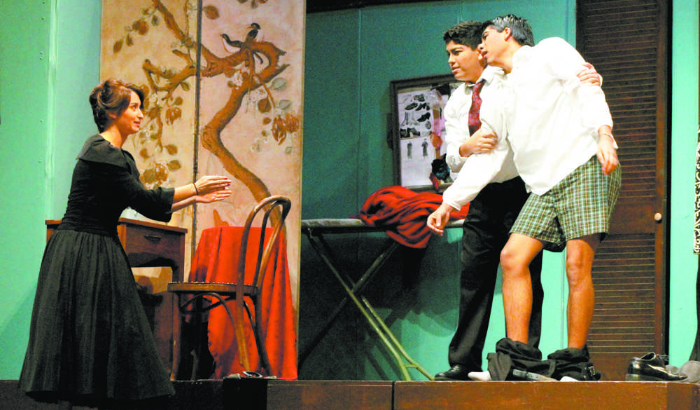 Junior Janice Franco's character confronts Senior Manuel Cantu's character on stage as he makes a fool out of himself and orders him to hide. Franco played Charlotte and Cantu played George, the leads, in Moon Over Buffalo.