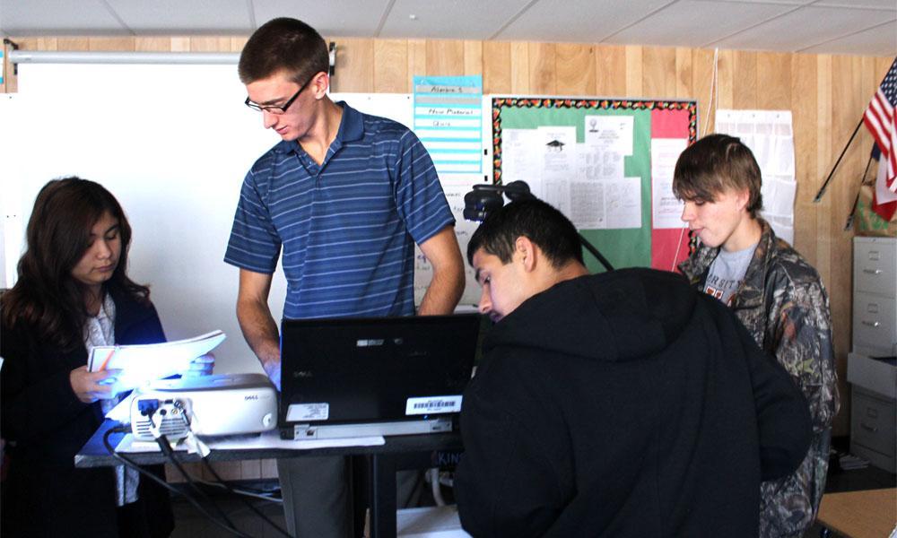 Alumni teacher Nikolas De Winnie lends his help to his freshman Algebra one class. De Winnie also teaches ninth grade STAAR remedial class.