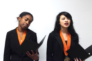 Junior Savannah Stookey and sophomore Tyra Williams practice their poetry for their next competition.