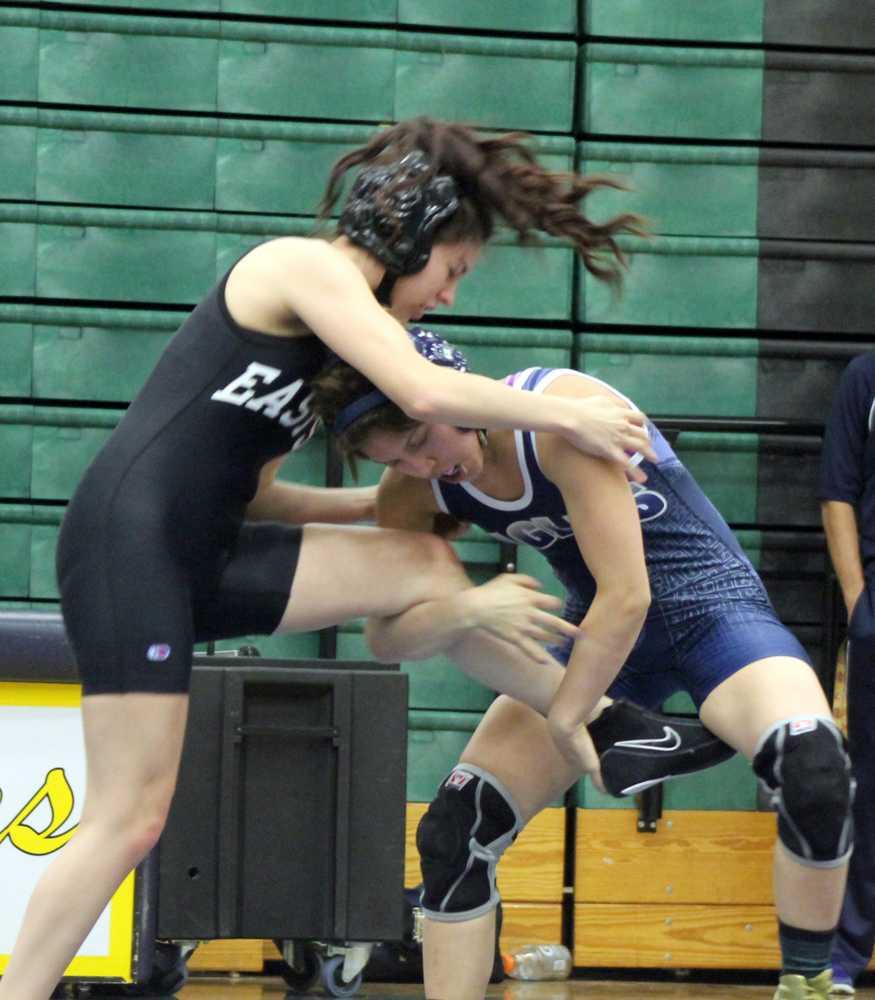 Junior+Anna+Becerra+preforms+a+single+leg+takedown+on+her+Eastside+Memorial+opponent.+Becerra+was+victorious.