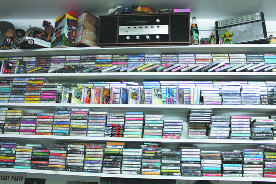 Vintage+cassettes+are+on+display+on+the+shelves+at+Turn+Table+Records.+Not+only+does+this+store+have+cassettes+and+vinyl+records%2C+he+also+sells+vintage+clothes+for+a+reasonable+price.