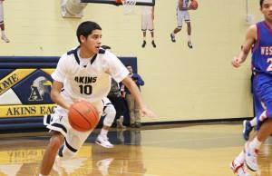 Boys basketball advances to playoffs