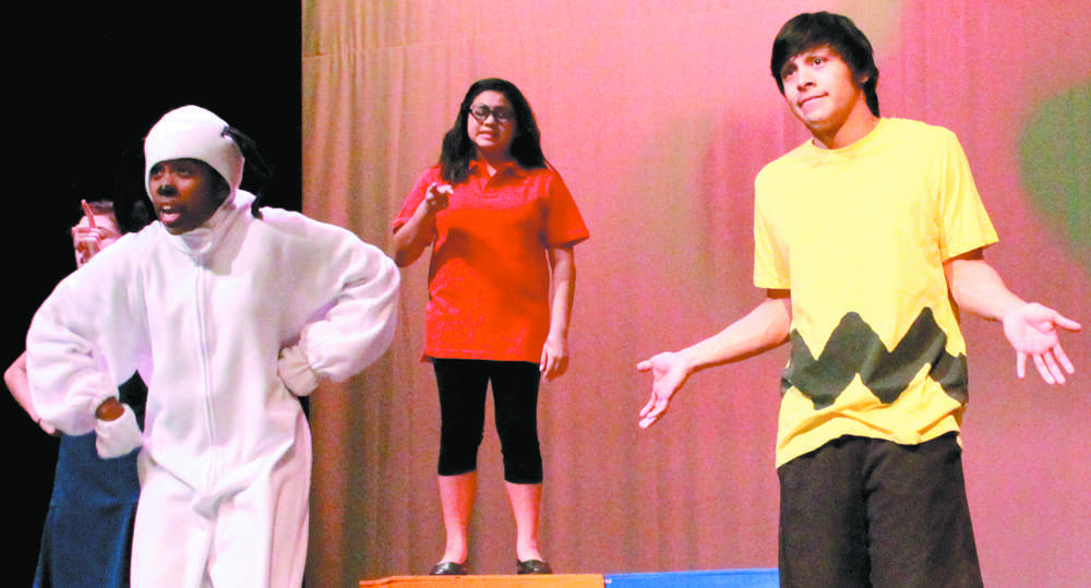 """Senior Christian Martinez  performs alongside his castmates at dress rehearsal for the production of """"Youre A Good Man Charlie Brown"""". Martinez plays Charlie Brown, the lead role in the play."""