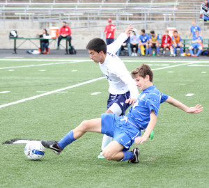 Senior midfielder Carlos Gutierrez eludes the Westlake opponent's slide tackle. The Eagles lost to Westlake by a dissapointing 4–0.