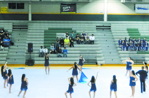 Winter Guard performs their routine at a competition in Cedar Park. They earned 6th place out of 9 at the competition.