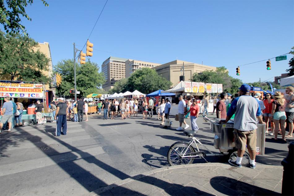 Attendees walk around taking in the sights of downtown Austin. Last year the event distributed nearly $20,000 in donations to non-profit organizations.