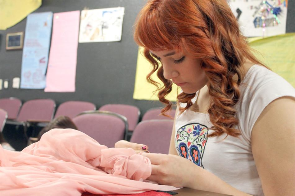Theater student Isabella Luna works on a costume for the play You're a Good Man Charlie Brown. Next year the Arts and Humanities Academy will offer a costume design class.