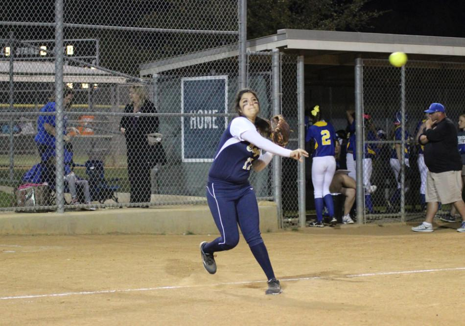Senior third baseman Alyssa Gonzalez throws the ball to first base for the out.