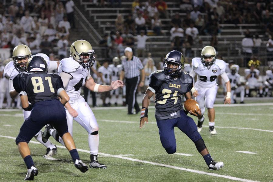 Akins wins first game of football season