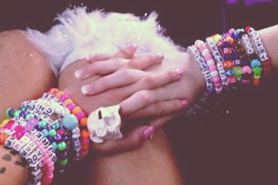 Ravers decorate themselves in