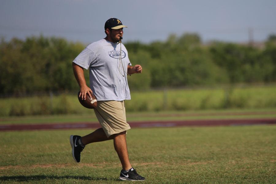 Coach Morton works after school practice.