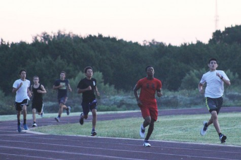 Runners meet at 6:30am to begin their early morning practice. It's a tough practice, but the hard-work shows.