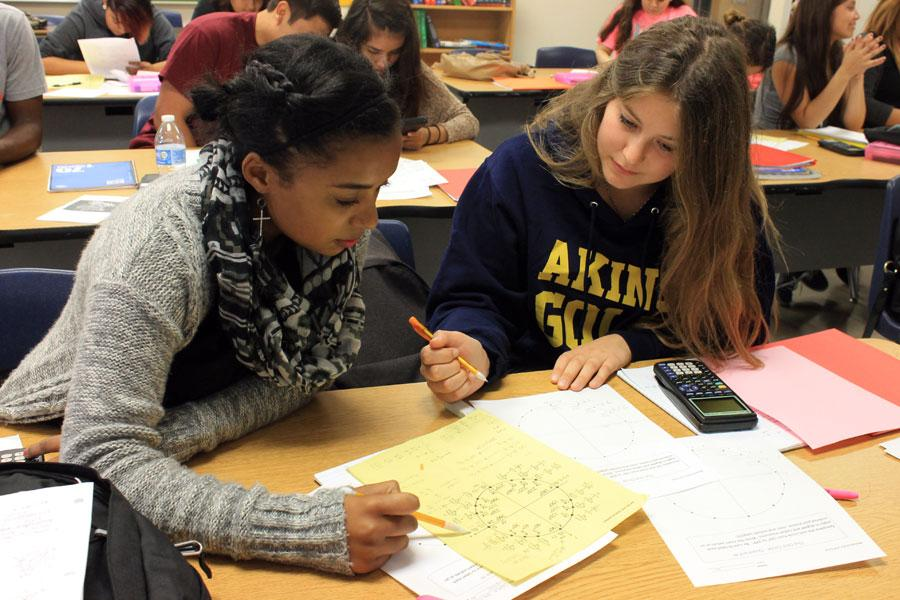 Maelle Baffert works on problems with a partner in Algebra 2 class.