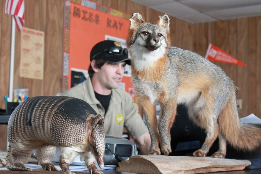 City+of+Austin+Park+Ranger+Matt+Rogers+visits+with+Green+tech+students+and+teaches+them+about+animal+identification.+Cadets+hope+to+gain+full-time+employment+when+they+complete+the+program.