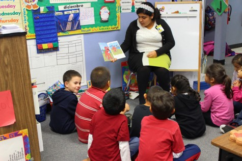 Junior Estefani Rodriguez is reading a book to the young children at Menchaca Elementary, preparing for the years ahead of her.