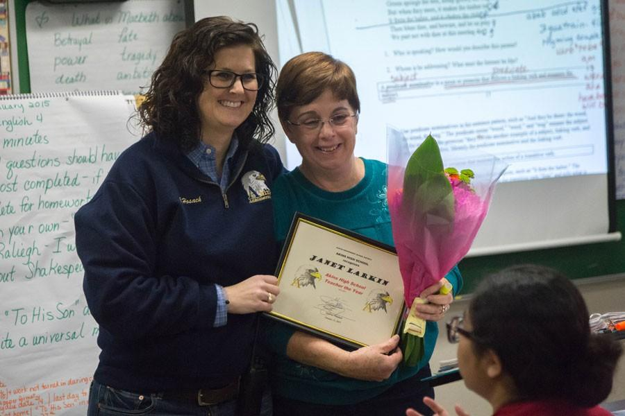 English teacher Janet Larkin receives her award for 2014-2015 Teacher of the Year.