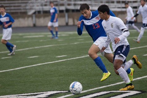 Senior Sergio Ruvalcaba takes the ball down field while being closely tailed by a Westlake player. The Eagles eventually suffered a 5-0 loss.