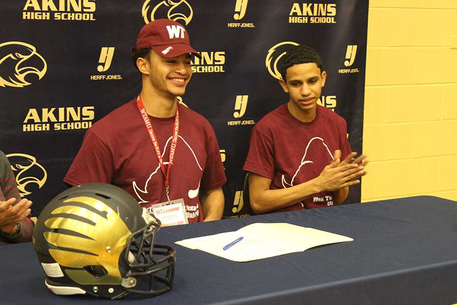 Omar Bailey signs letter of intent to play football for West Texas A&M University.
