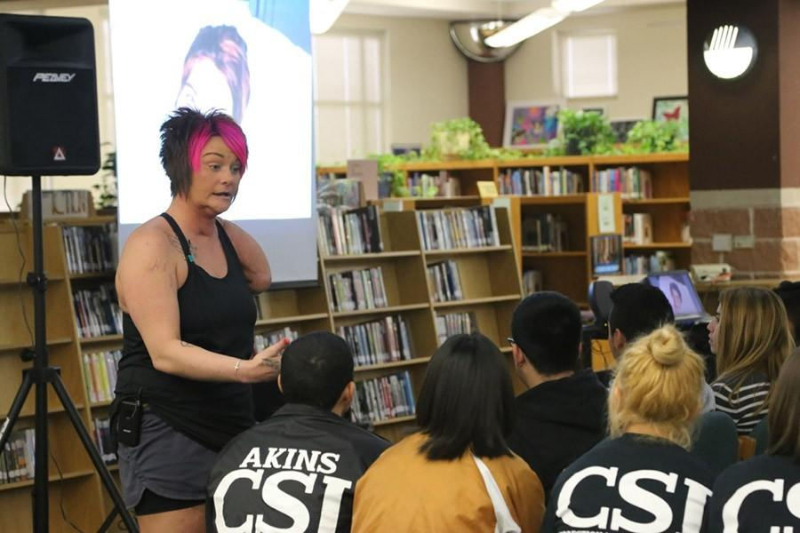 Guest speaker Sarah Panzau-Evans talks to a group of Akins students about the dangers of drunken driving on Tuesday in the library.
