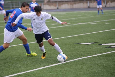 Senior Sergio Ruvalcaba defends the ball in a game against a player from Westlake High School. Akins lost the game 5-0.
