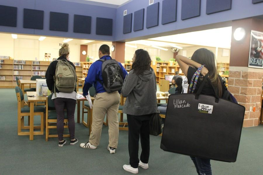 Students prepare to sign in for a three-hour long Saturday School session in the library.