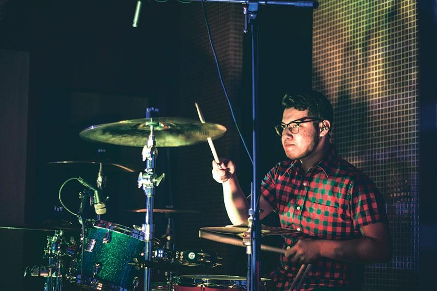 Senior Roy Cisneros drums along at a live performance in San Antonio, Texas with his fellow band mates  at a concert. This was their first huge gig where they sold band merchandise