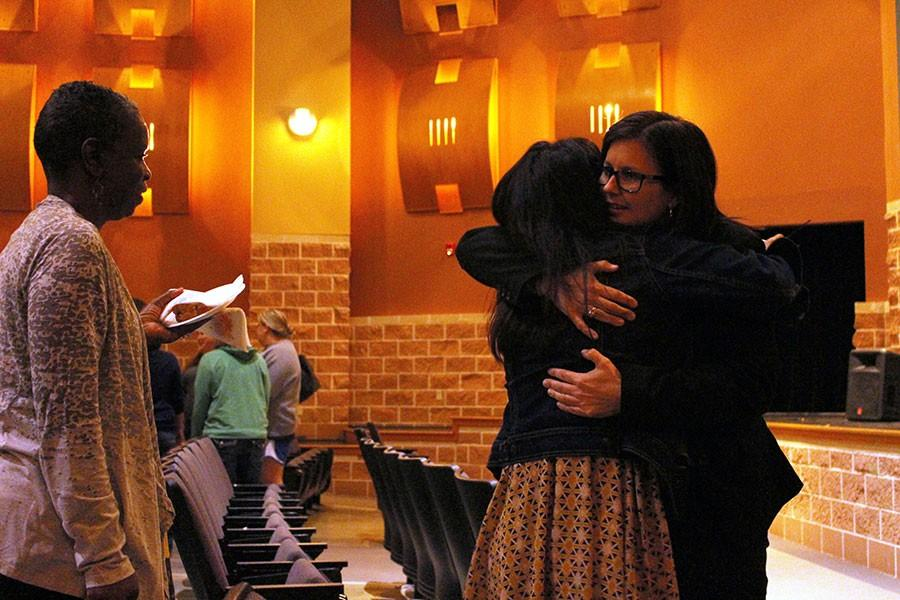 Principal Brandi Hosack hugs a faculty member during the Tuesday morning announcement meeting.