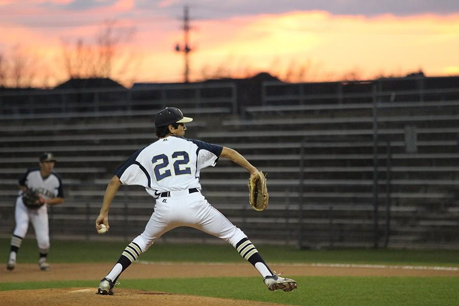 Senior Michael Garcia pitches in a game against Anderson in March. This year Garcia has been one of the main pitchers for the team.