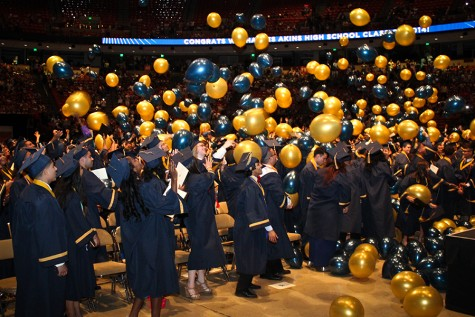 Members of the Class of 2014 enjoy the ballon drop during graduation ceremony at the Erwin Center.