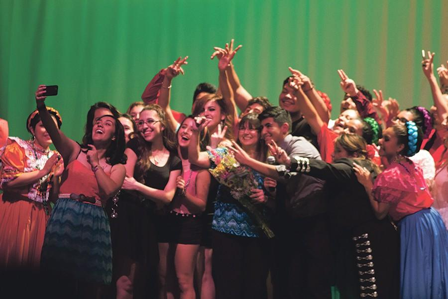 """Everyone who contributed to this event gathered around Spanish teacher Gina Garcia while  senior Flor Méndez captured the selfie that ended the night.""""It was a great experience working with all these kids,"""" Garcia said."""