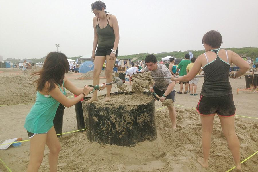 Students+create+the+foundation+for+their+UFO+sand+sculpture+at+the+annual+Port+Aransas+Texas+Sandfest+in+April.