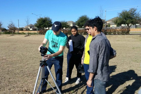 "Doug Crabb shows seniors Javier DeLeon, Joshua Spence and Taylor Organ how to set up a shot for their film called ""School Boy."" The student produced film, directed by junior Diego Rivera, was about a student overcoming a dark past through friendship."