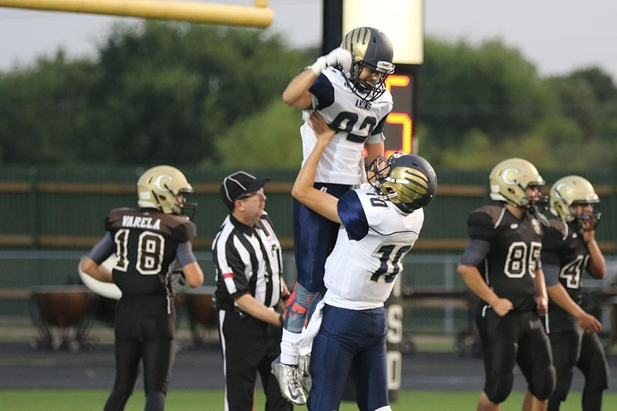 Michael Gonzales celebrates touchdown  with Trey Akers at Crocket game.