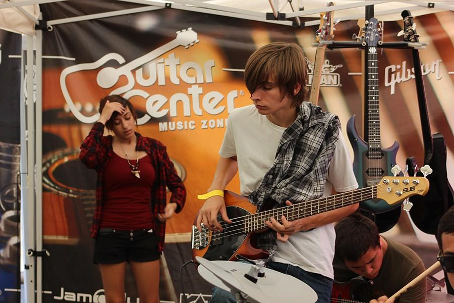 Sophomore Ethan Riley rocks out on a Sterling 5, provided by one of the various booths at High School Nation.
