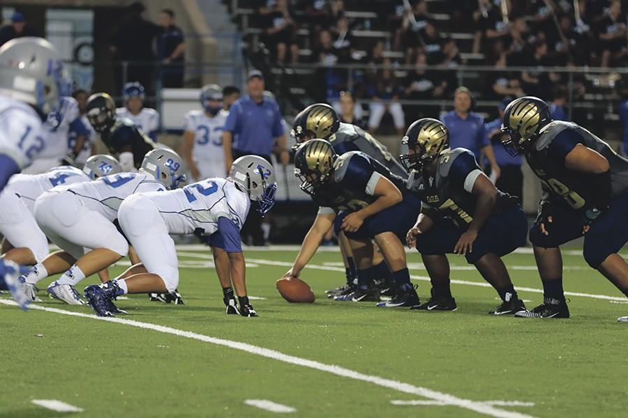 Outside linebacker Demarcus Cabezas receives a pass as teammates provide coverage during Homecoming game against the Lehman Lobos. Akins won the game with a score of 25-10, making school  history with the first Homecoming game win.