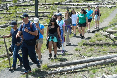 Akins students walk through Yellowstone National Park, appreciating the scenic route. The students are a part of Ramos