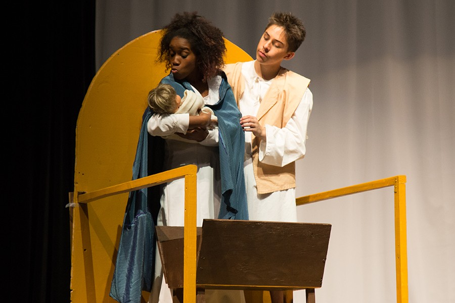 Senior Tyra Williams and freshman Jonathan Mecedo hold an infant Jesus in The Best Christmas Pageant Ever!, which is just one of several winter fine arts performances going on.