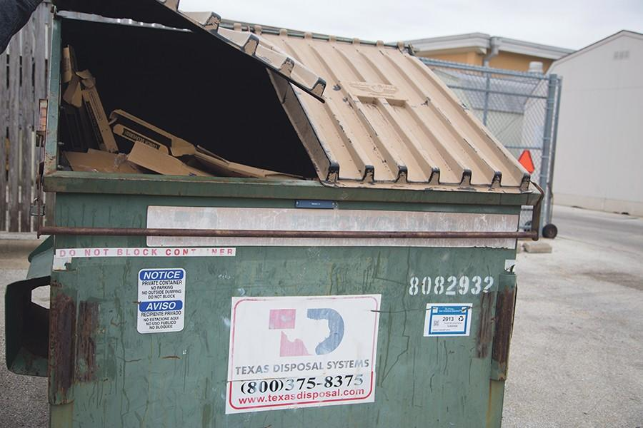 There are three containers for trucks to pick up recycling at Akins. Recycling advocates have expressed concern about what is being recycled and how efforts can be improved on campus.