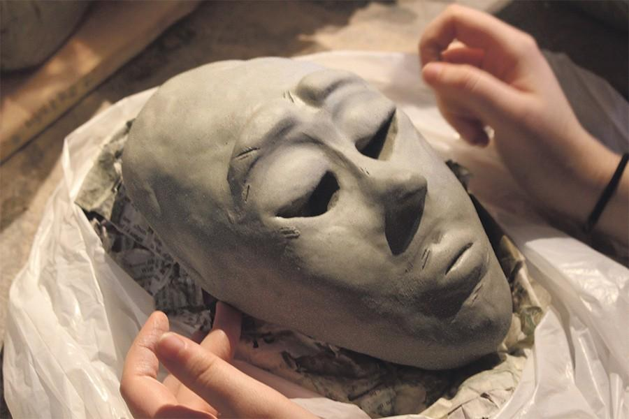 Senior Jana Cordero meticulously sculpts a bust of a face in Eric Cannon's ceramics class that she is preparing to take to vase.