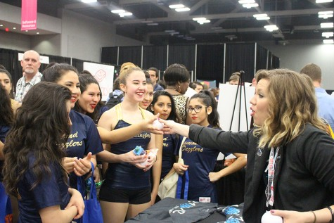 Diamond Dazzlers actively listen to a booth  about stress relief in school.