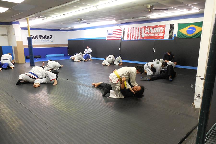 Marcelo Cruz' class at Vandry Brazilian Jiu Jitsu. The students team together and practice fighting tactics.