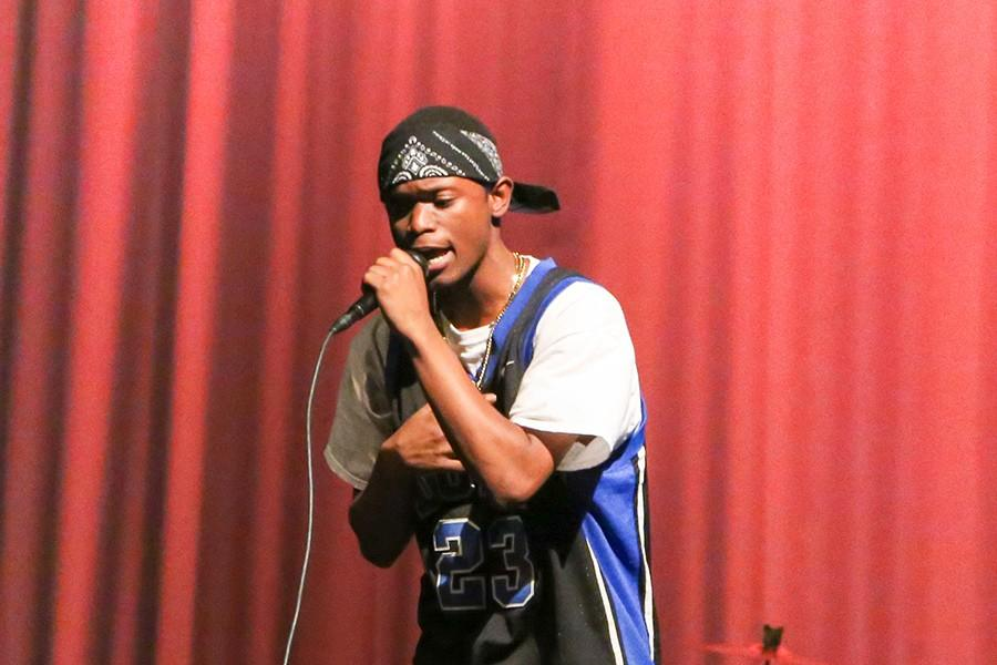 Freshman Julius Jones continues his performance despite the technical difficulty with the microphone, providing a great and enthusiastic energy for the audience.