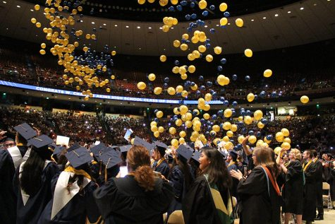 Blue and gold balloons fall from the top of the Frank Erwin Center after the Class of 2016  walked the stage on June 4 at the Frank Erwin Center.
