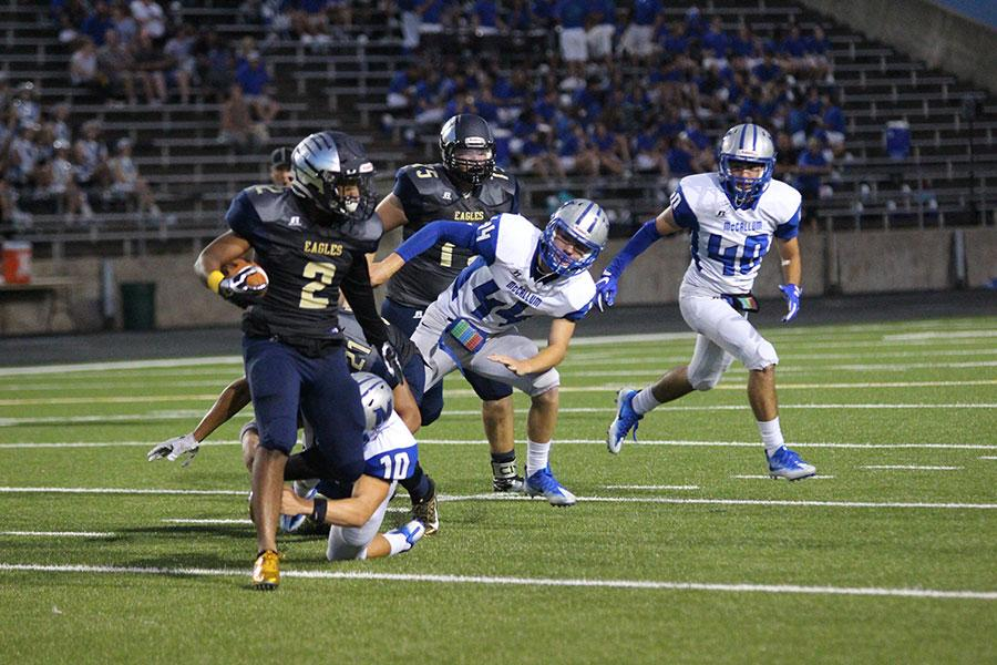Running back Keenan Lockhart evades a defenders tackle in a game against the McCallum Knights. Akins lost this game 17-7.