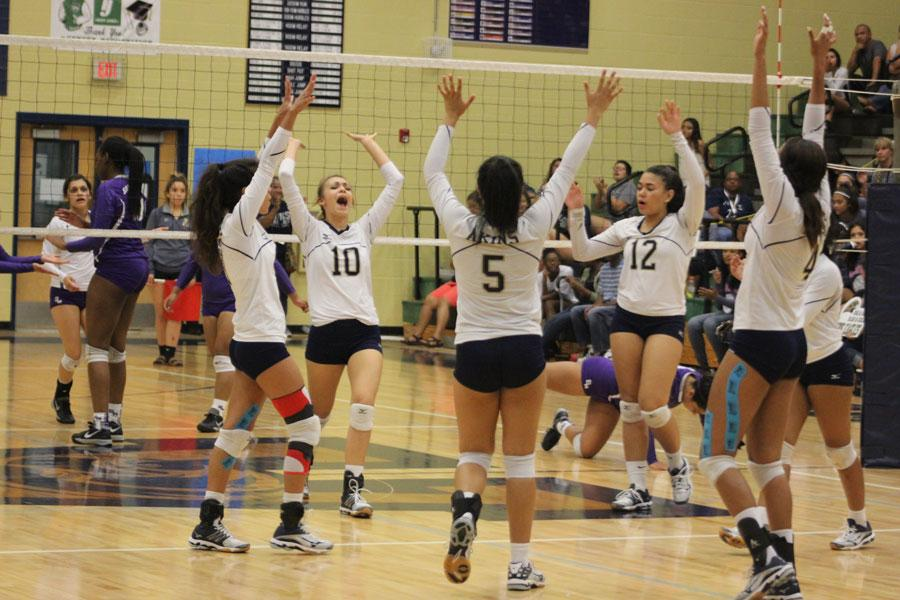 Akins' varsity volleyball team celebrates during game against San Marcos Rattlers on 9/23/16.
