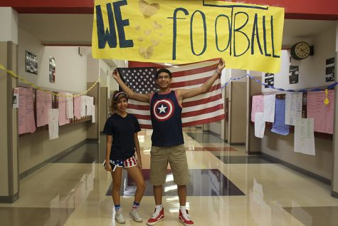 Students pose with the USA flag on